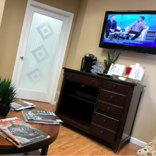Waiting room TV and magazines at Bawa Dentistry in Centreville