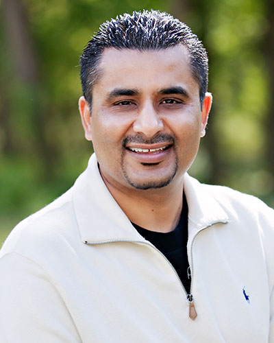 Dr. Bobby Bawa who is a dental implant dentist in Manassas, VA