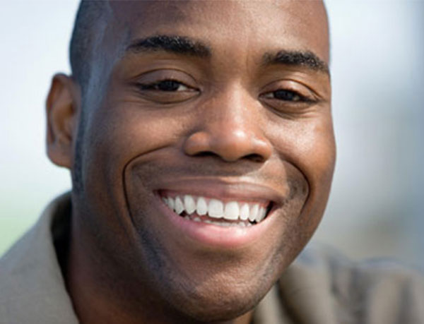 Man enjoying his smile design treatment from his cosmetic dentist in Manassas